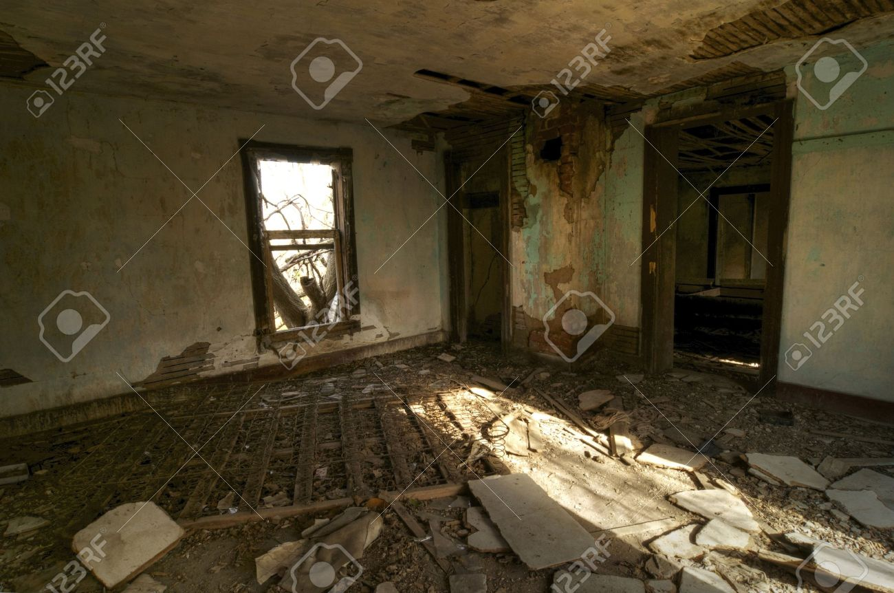 A Bedroom left in Rubble in an Abandoned House Stock Photo - 11830486
