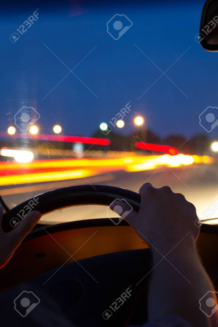 Car Driving At Night View From Inside The Car Men S Hands On Stock Photo Picture And Royalty Free Image Image 127422629