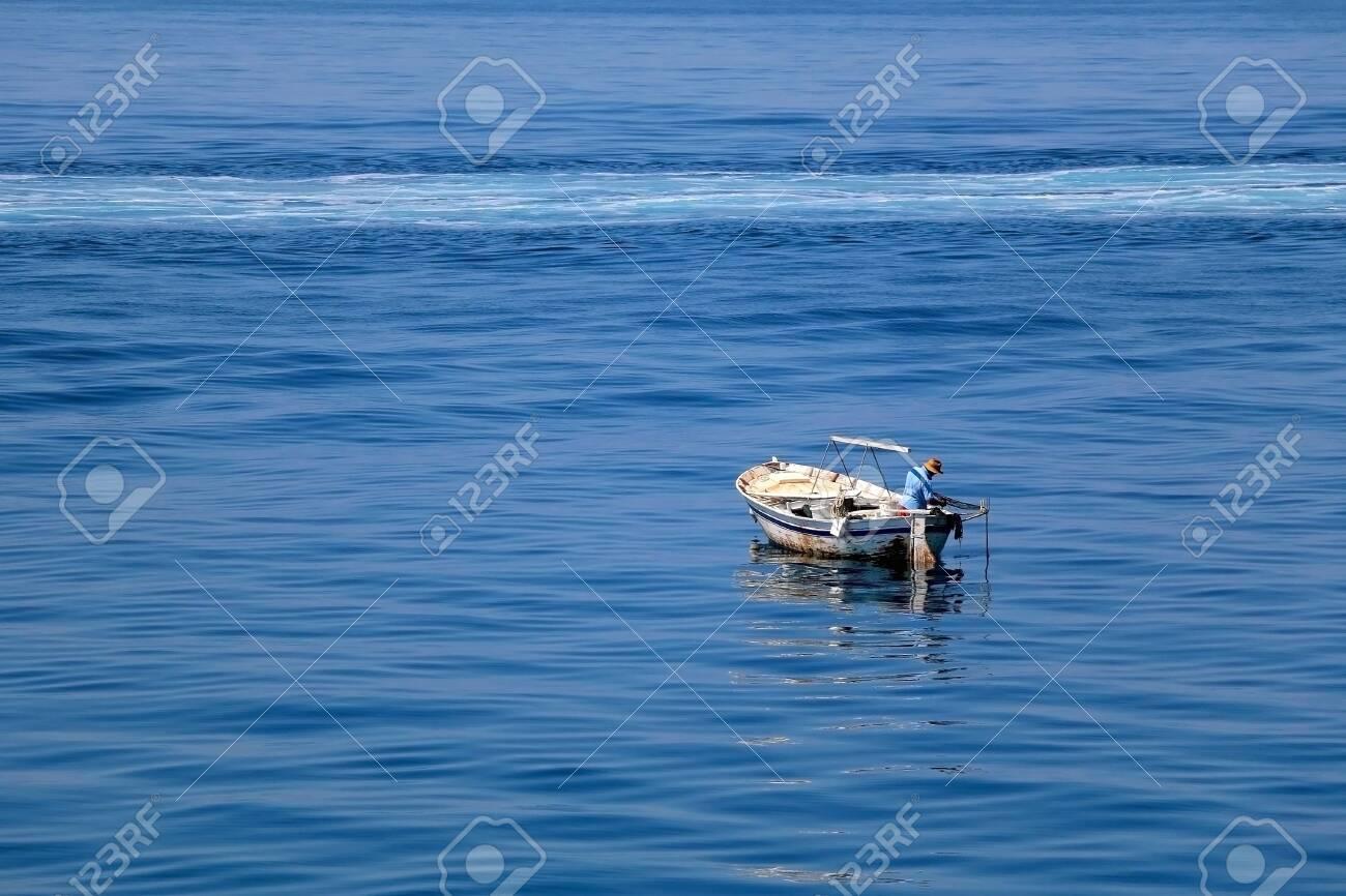 Unrecognizable fisherman on a small rustic fishing boat in Croatia. - 141666743