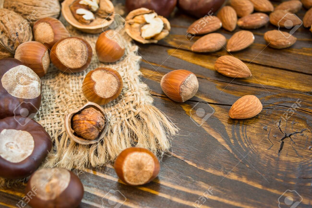 Mix of different nuts on a rustic background. Close-up photo with copy space. Healthy nutrition concept. - 133178978