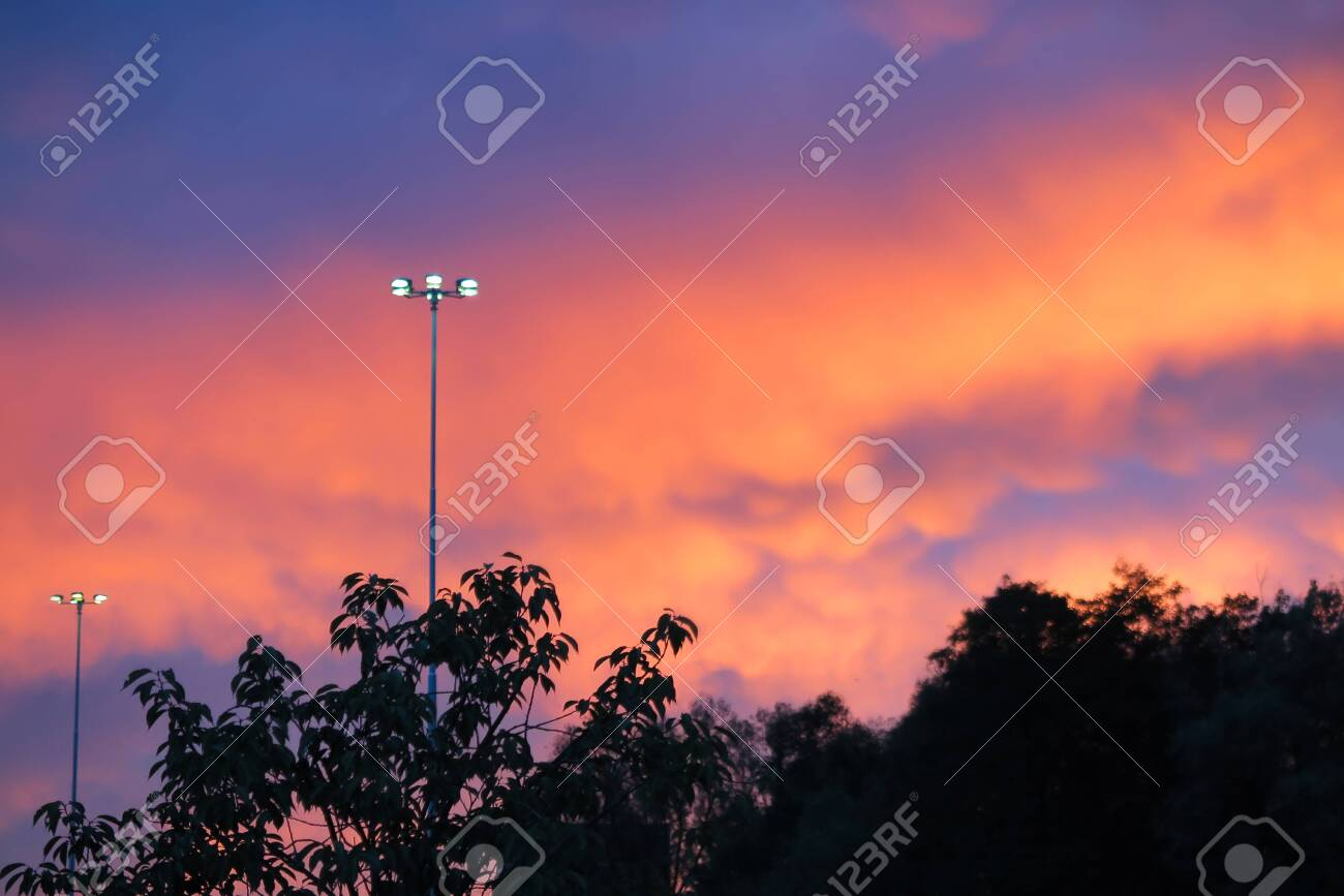 Pink And Purple Sunset With Clouds And Lonely Lamp Above Dark Stock Photo Picture And Royalty Free Image Image 128377324