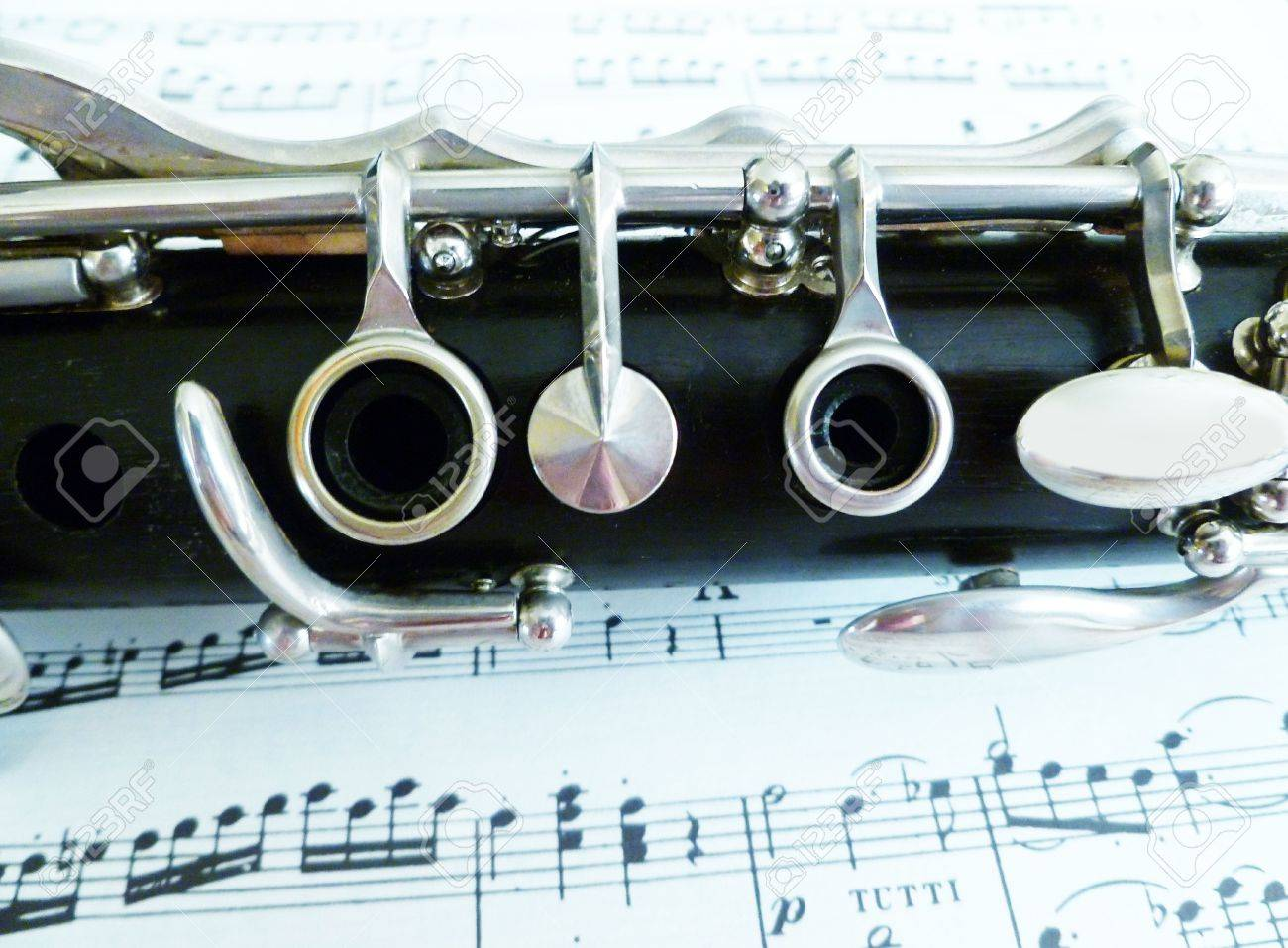 Sheet music with a view of the top clarinet joint. Stock Photo - 10294888