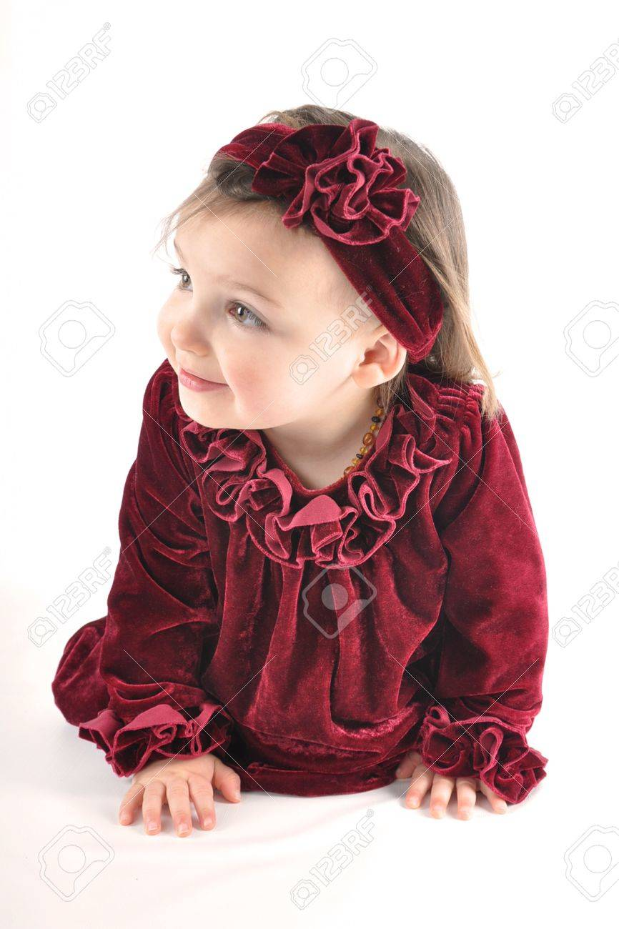 Profile Of Crawling Baby In Crimson Red Dress Against White ...