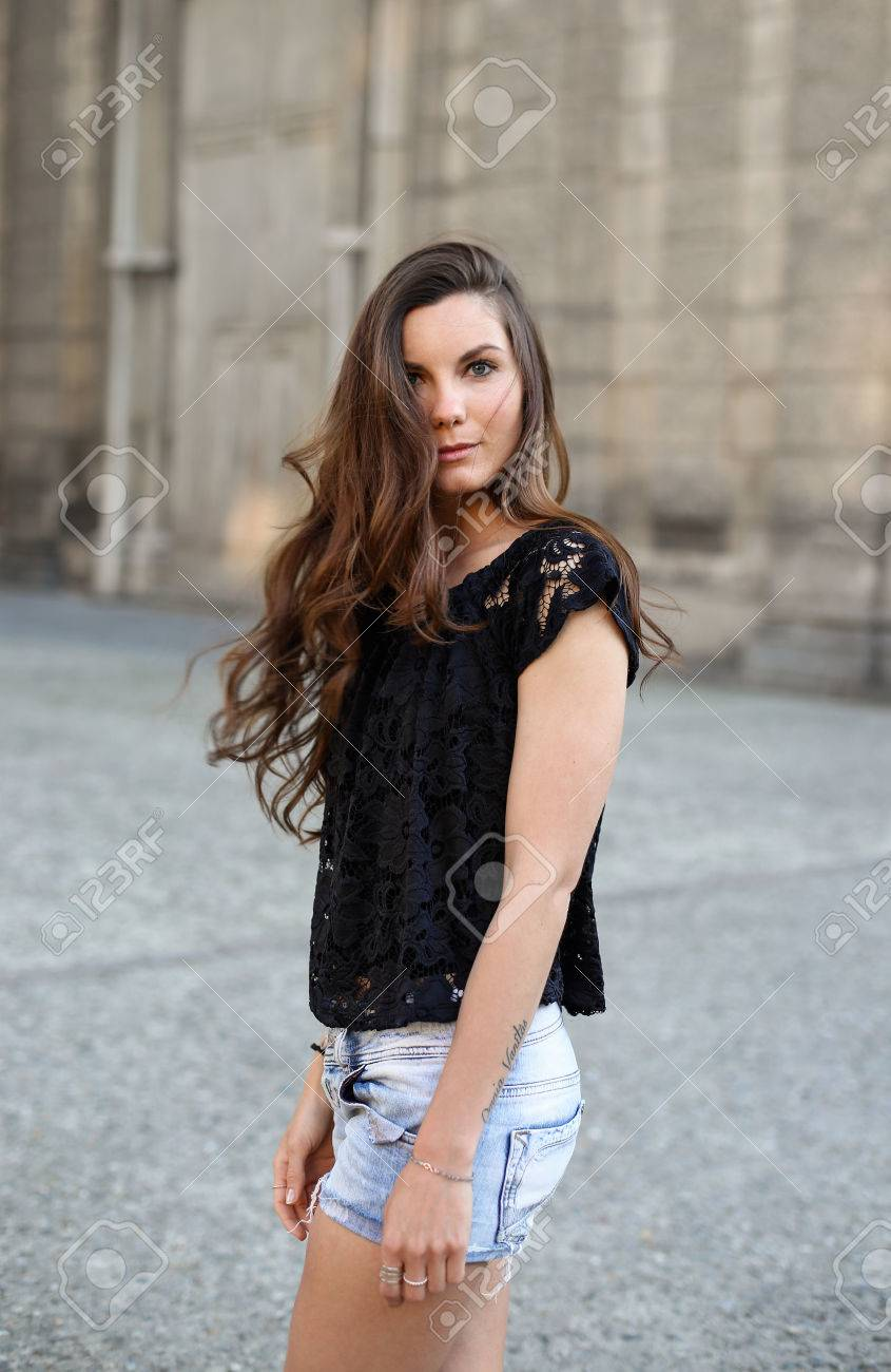 Attractive stylish girl wearing shorts on the street summer time Stock  Photo - 41159186 4baf836c6
