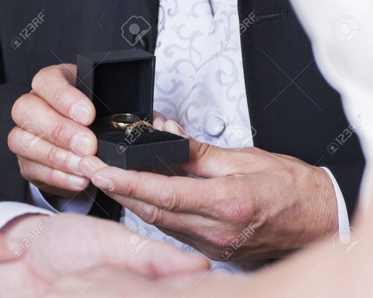 Best Man Presenting Gold Wedding Rings To Bride And Groom At.. Stock ...