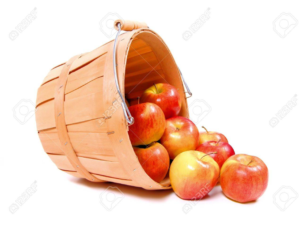 A group of apples spilling from a wooden farmer's basket Stock Photo - 8953733