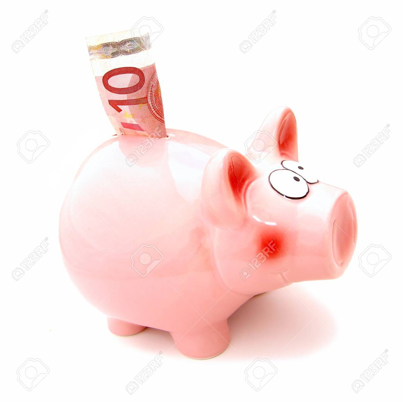 Piggy bank with 10 denomination bill in its slot Stock Photo - 10304171
