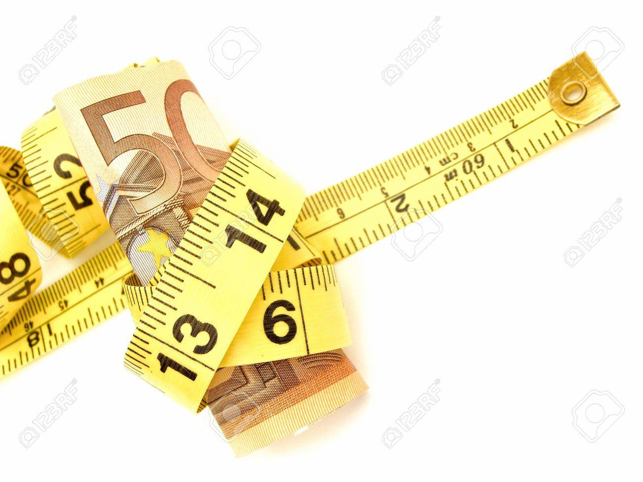 Tied up: Fifty Euro notes wrapped in a measuring tape Stock Photo - 10303717