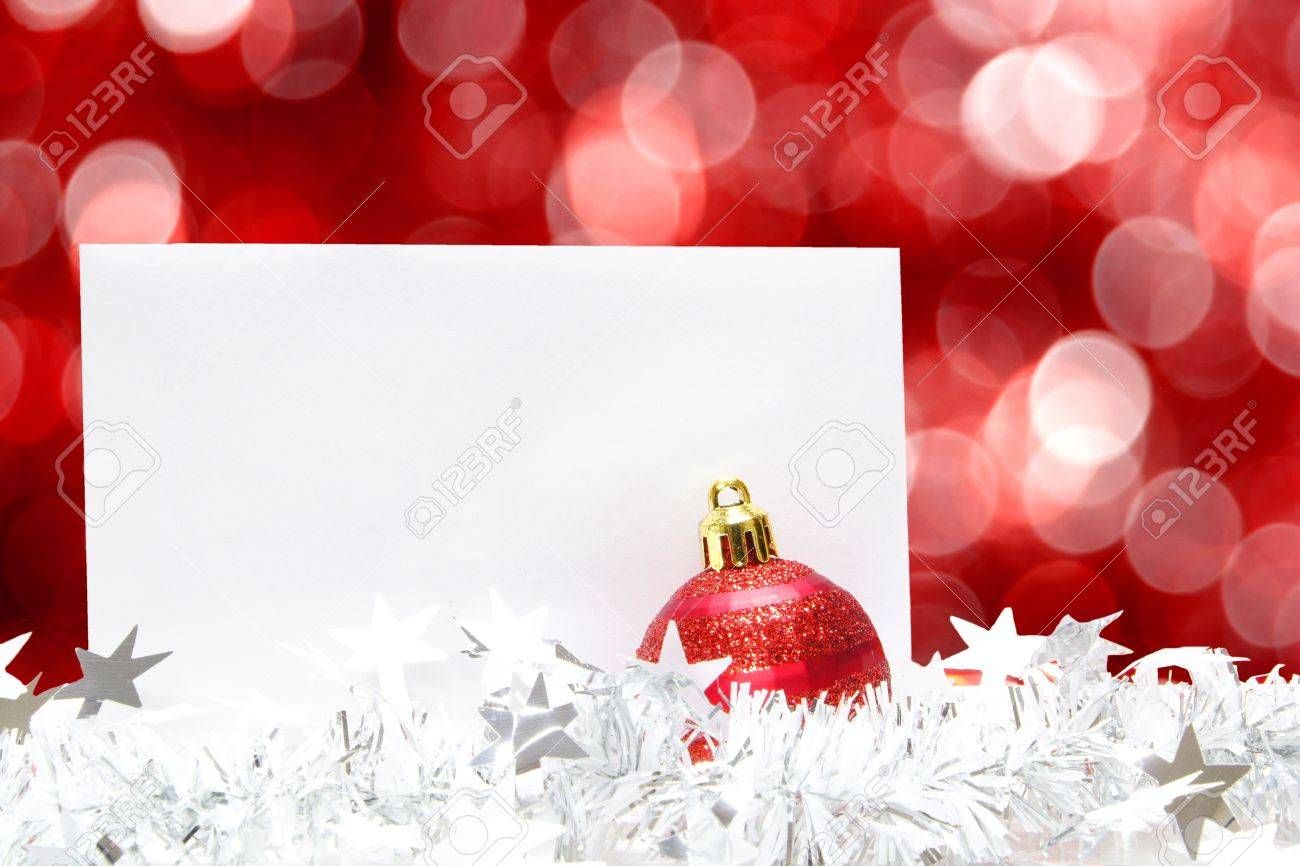 Blank Christmas greeting card with bauble, garland and abstract red light background Stock Photo - 11256863