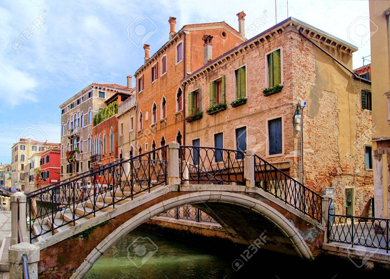 Bridge and architecture along the canals of Venice, Italy Stock Photo -  12327097
