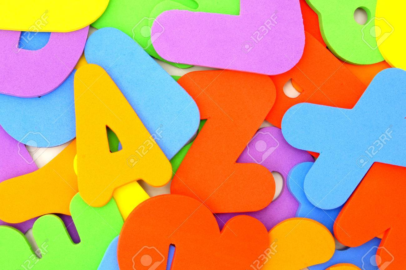 child s toy foam letters and numbers forming a colorful background stock photo 14489887