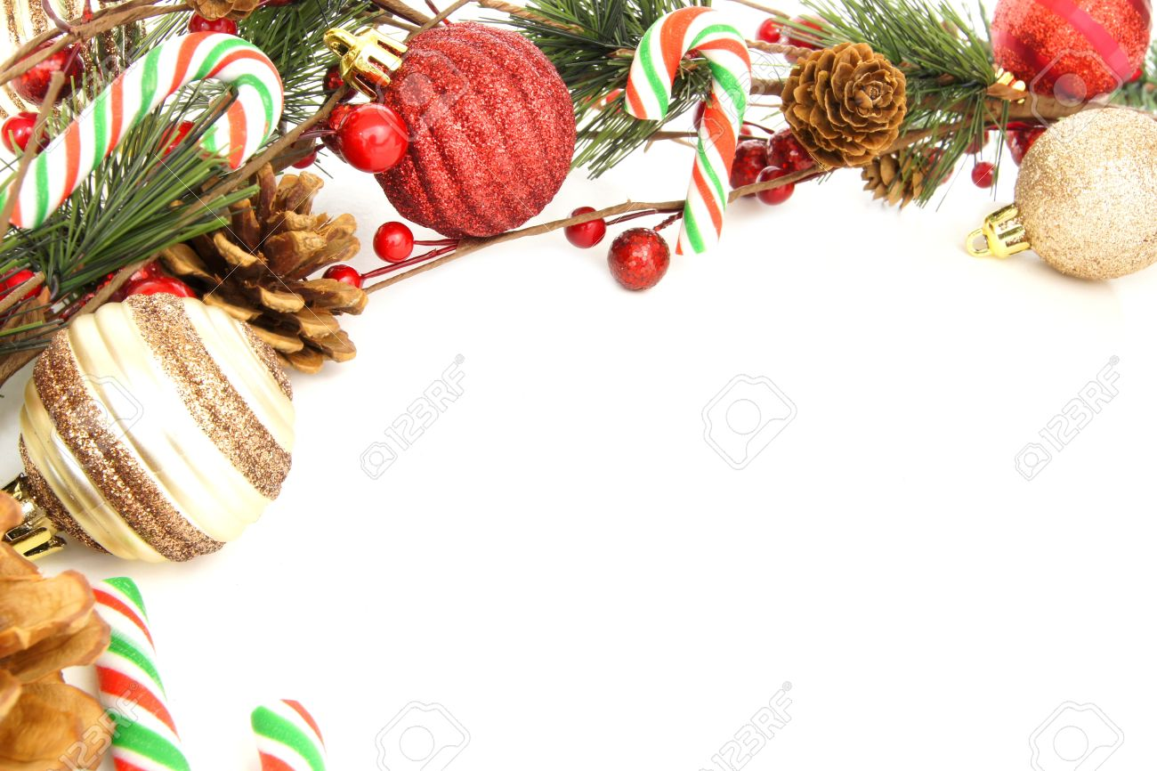 Christmas Corner Border With Baubles, Tree Branches And Candy Canes Over  White Stock Photo