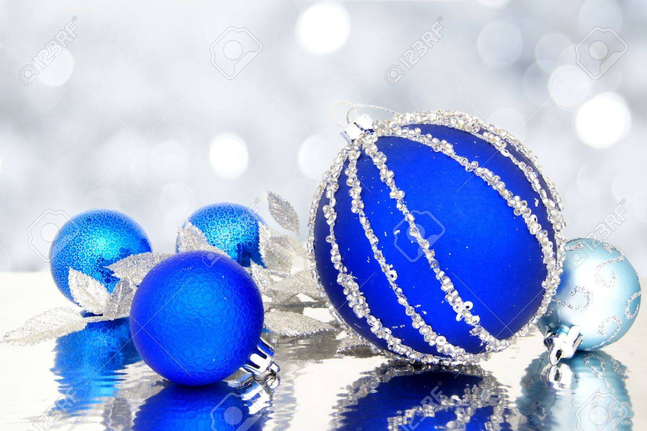 Blue Christmas baubles with twinkling light background Stock Photo - 16386047