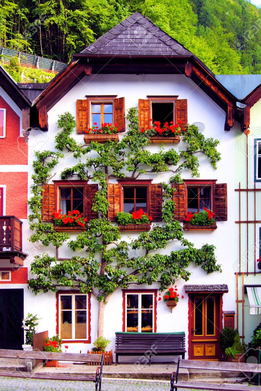 Traditional House With Flowers In Hallstatt Village Austria Stock