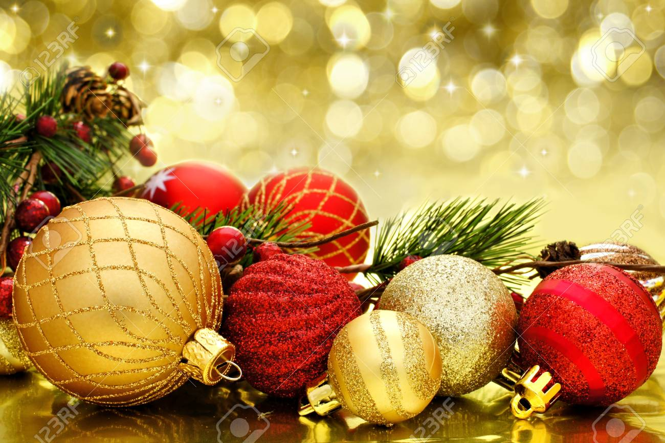 92b4a08550d1 Red and gold Christmas baubles with twinkling golden background Stock Photo  - 23638699