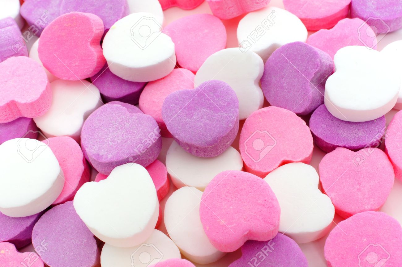 24865533-valentines-day-background-of-pink-purple-and-white-candy-hearts.jpg