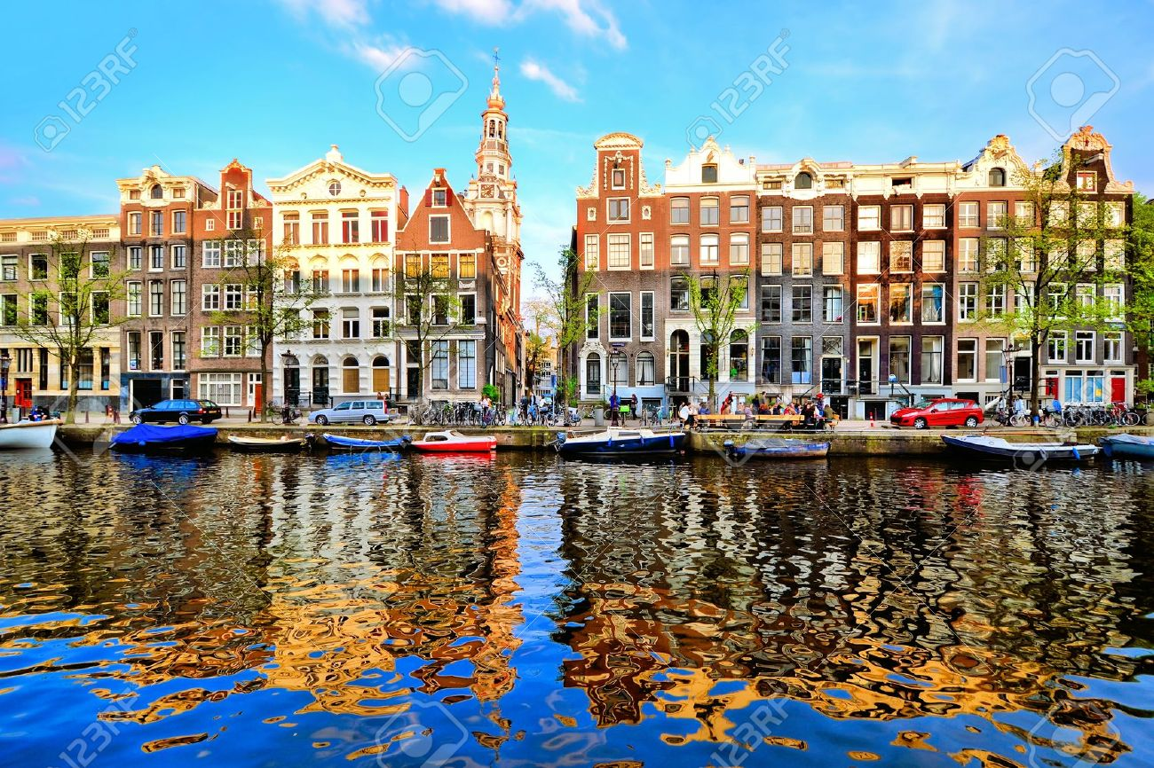 Canal houses of Amsterdam at dusk with vibrant reflections, Netherlands - 28956770