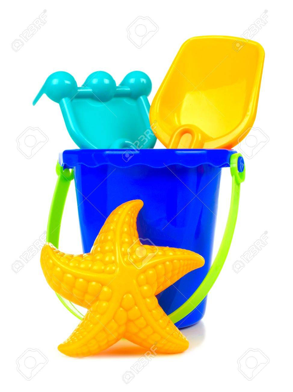 Uncategorized Toy Pail toy sand pail with rake shovel and starfish over a white background stock photo