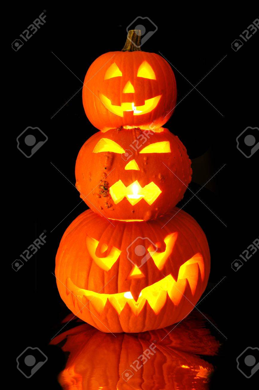 group of stacked halloween jack o lanterns with black stock photo