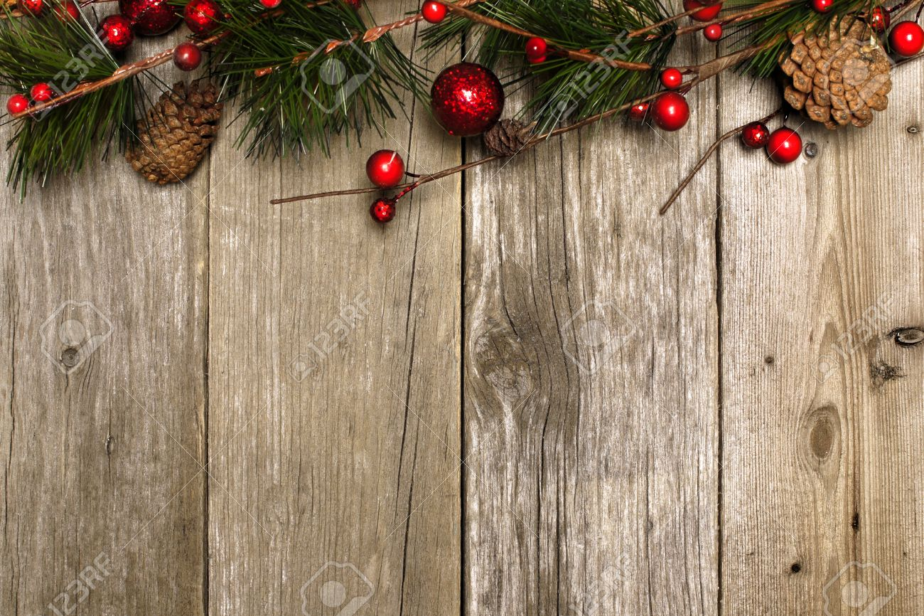 Christmas Wood Background.Aged Wood Christmas Background With Branch And Bauble Top Border