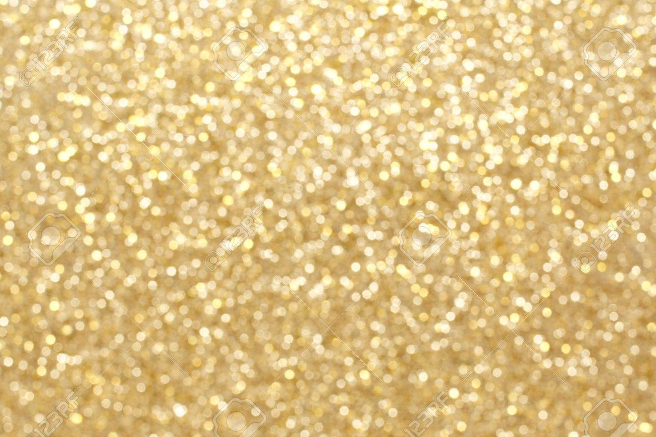 Gold Twinkling Light Background For Christmas Or New Years Eve Stock Photo