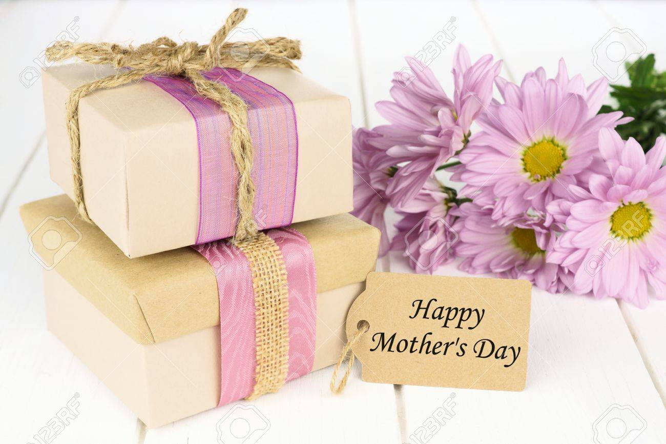 Handmade Gift Boxes With Happy Mothers Day Tag On White Wood
