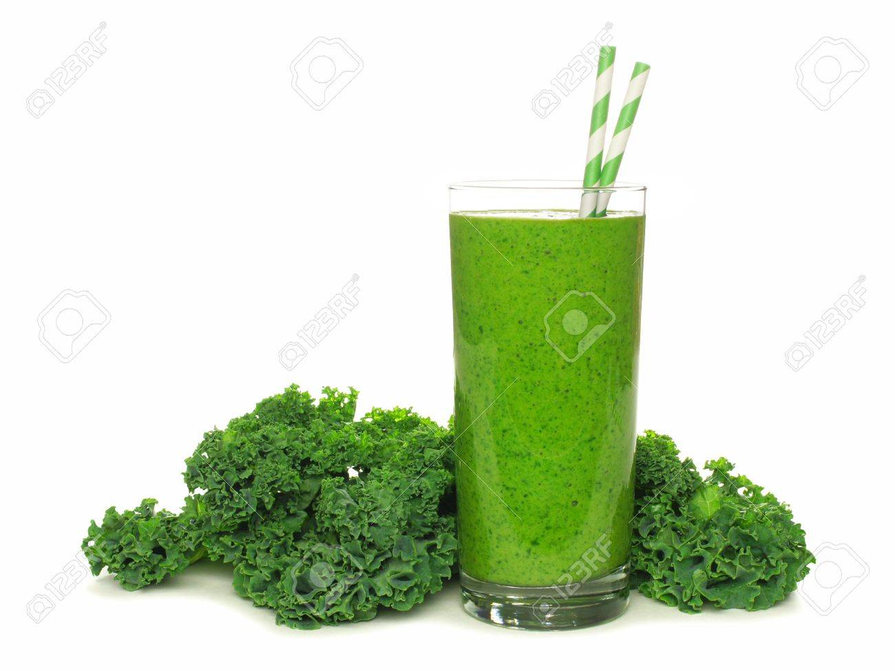 Healthy Green Smoothie With Kale In A Glass With Straws Isolated