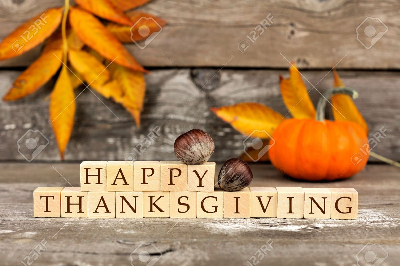 Happy Thanksgiving Wooden Blocks Against A Rustic Wood Background With Pumpkins And Autumn Leaves Stock Photo