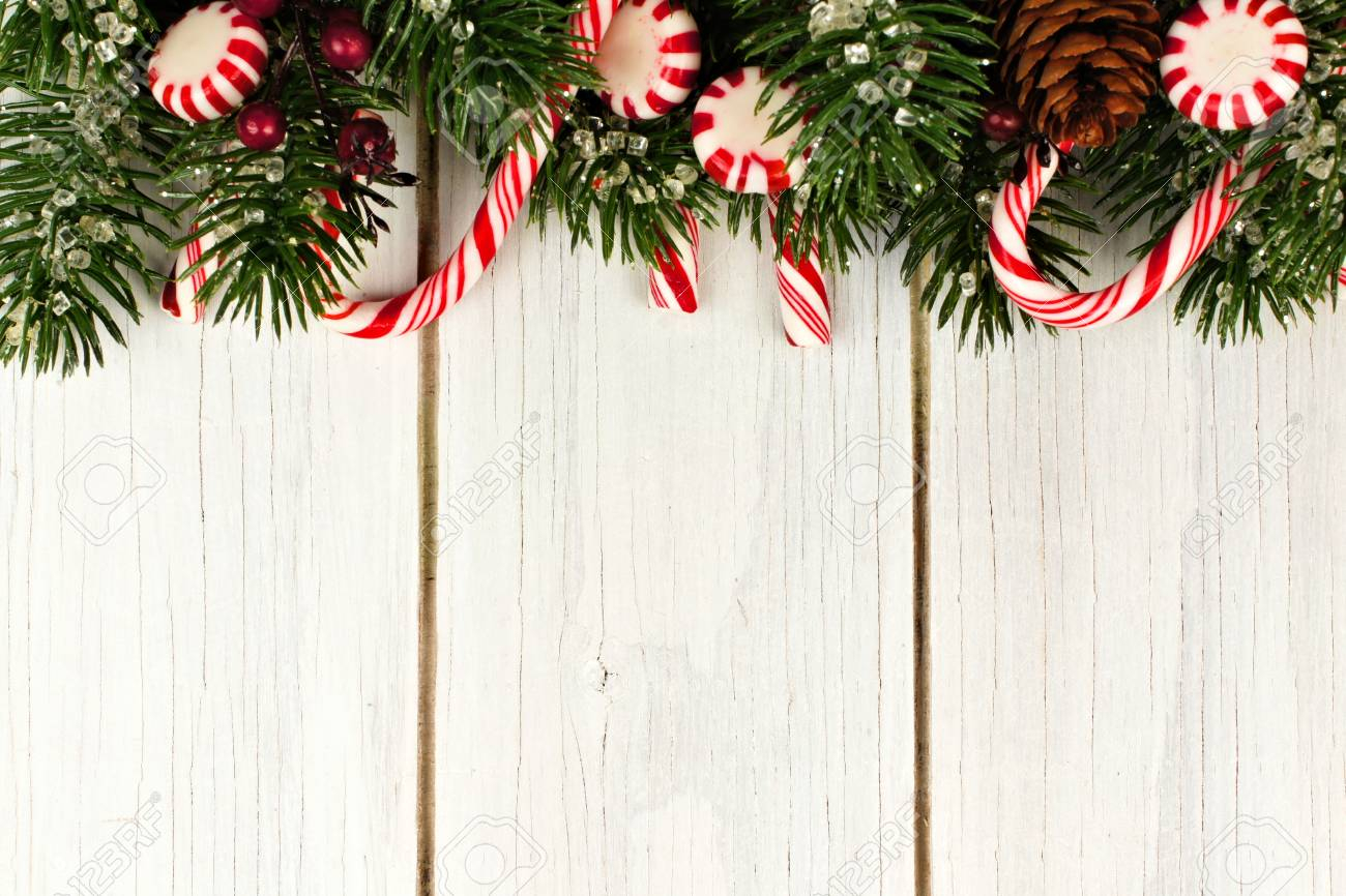Christmas Top Border.Christmas Top Border Of Branches And Candy Canes Against A White