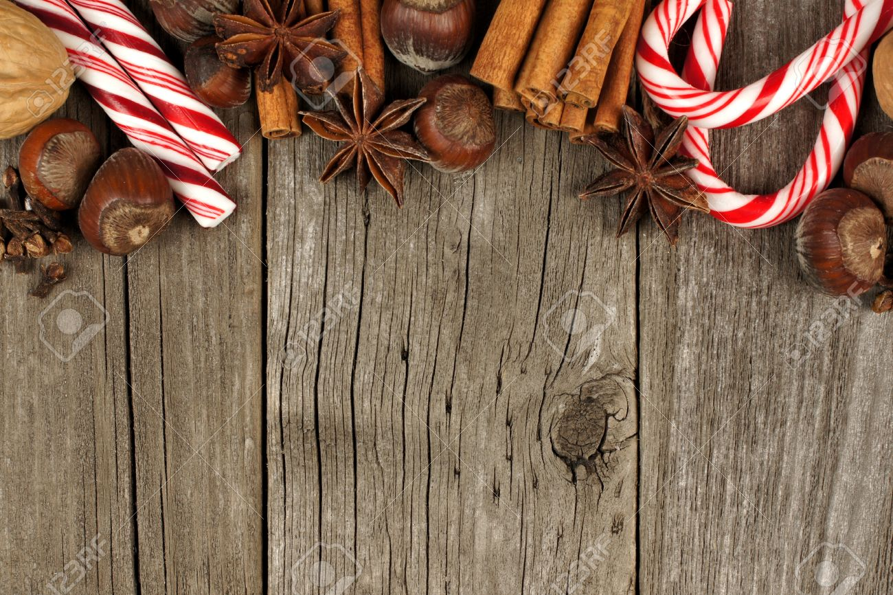 Top Border Of Christmas Baking Goods And Candies Against A Rustic