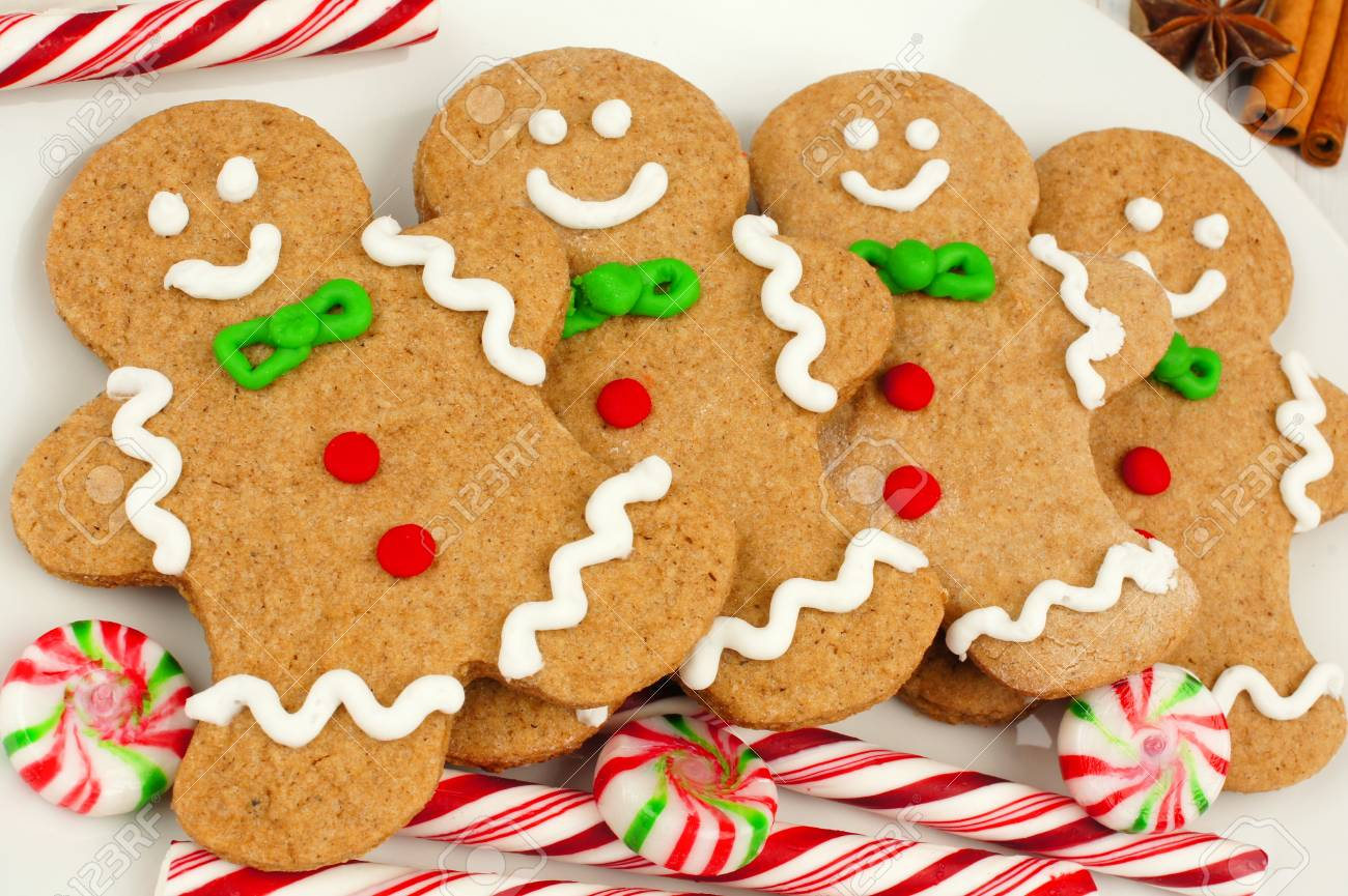 Group Of Christmas Gingerbread Man Cookies On Plate With Candy