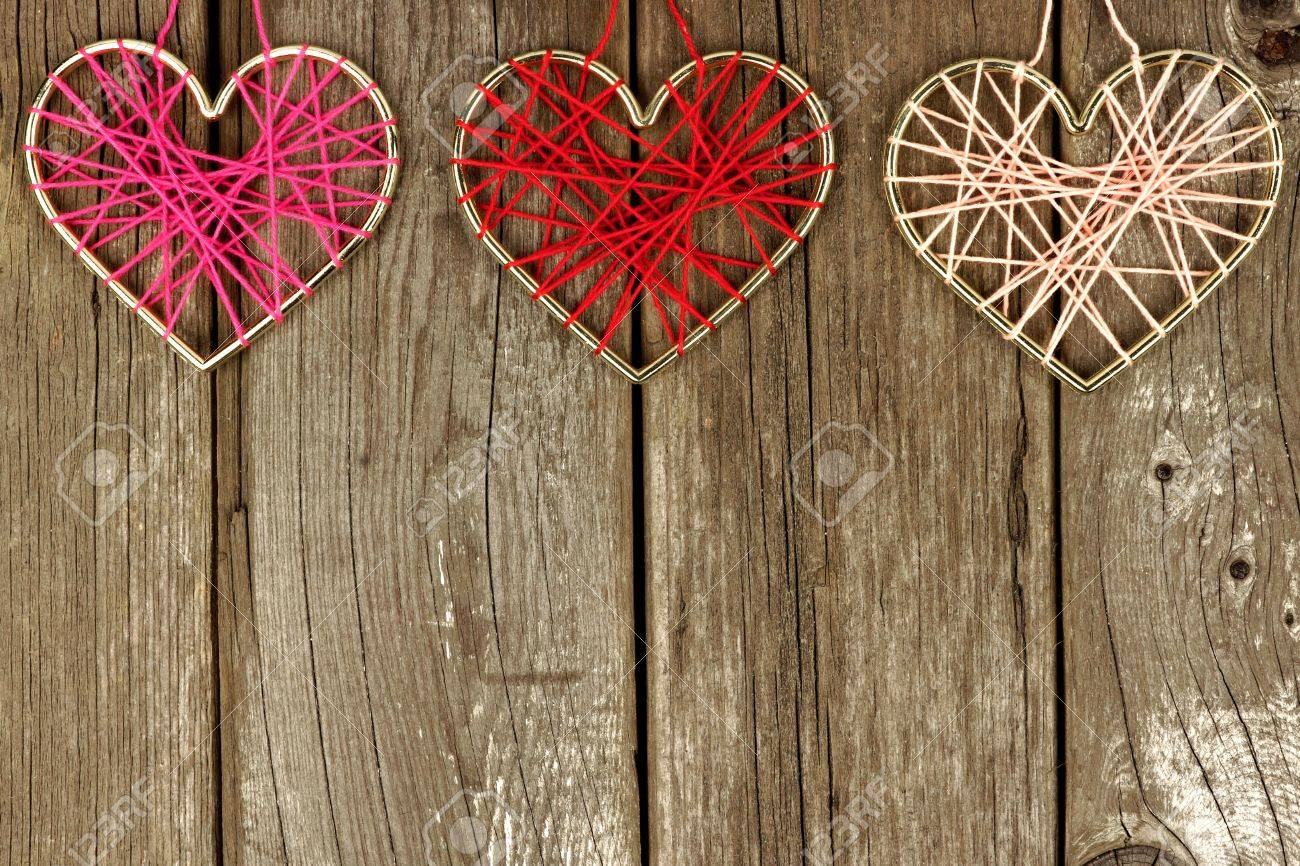 Valentines Day Yarn Hearts Forming A Top Border On Rustic Wood