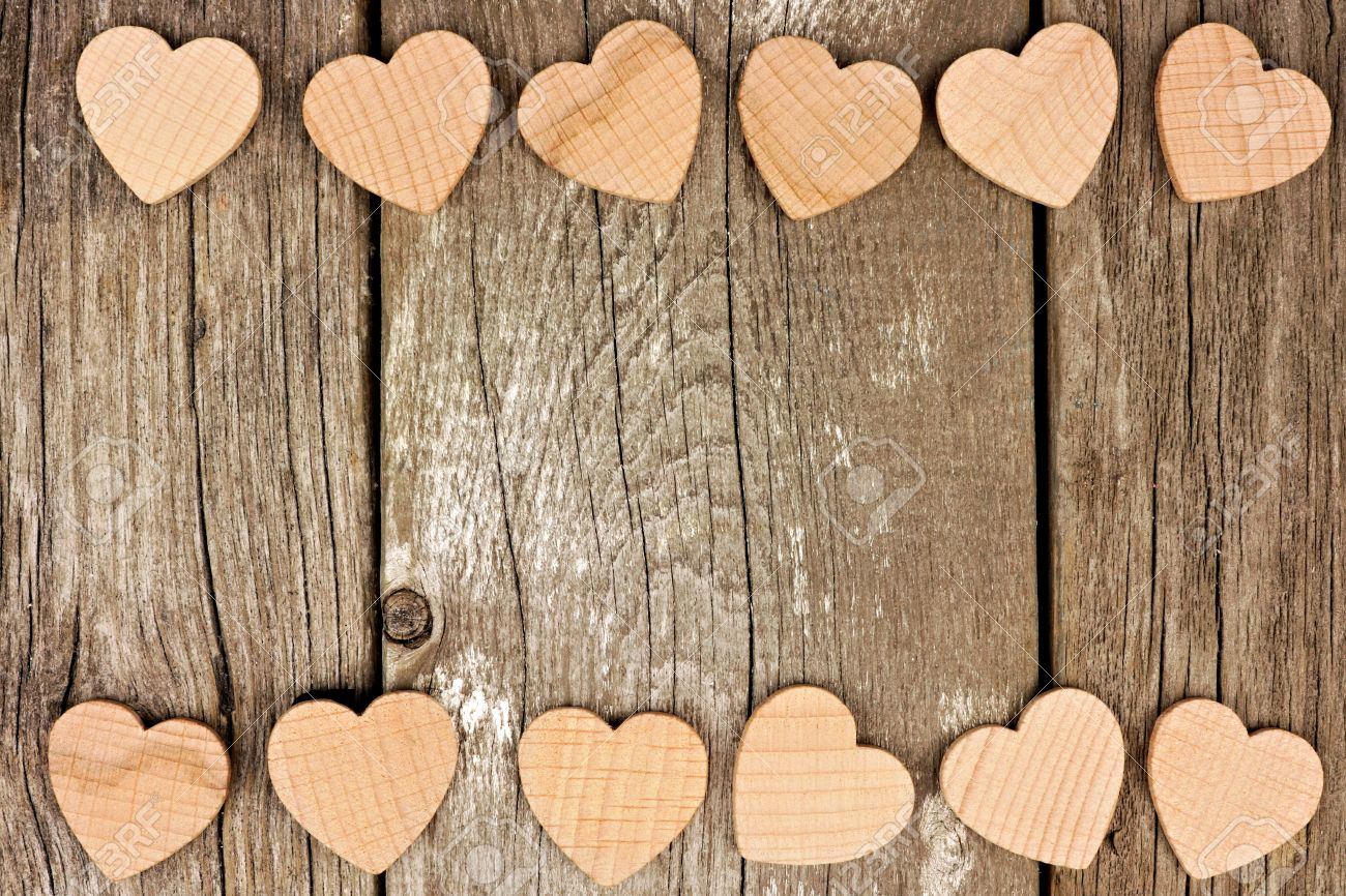 Valentines Day Wooden Hearts Forming A Double Border On Rustic Wood Background
