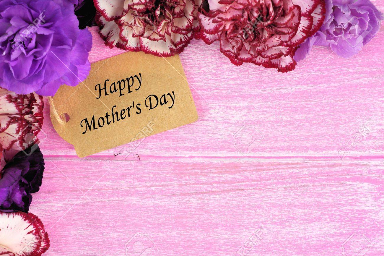 Happy Mothers Day Gift Tag With Carnation Flower Corner Border On Rustic Pink Wood Background Stock