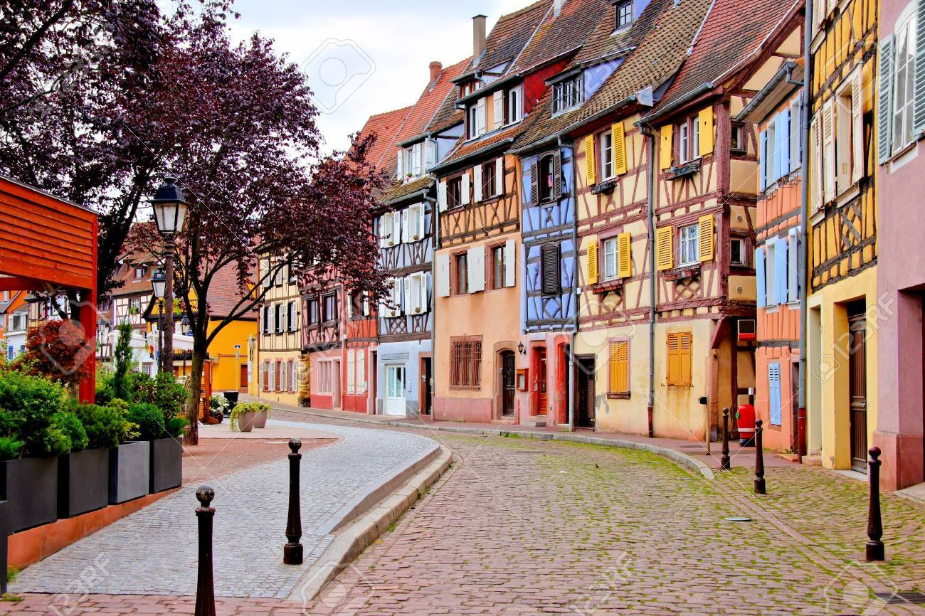 Quaint colorful houses of the Alsatian city of Colmar, France - 59195002