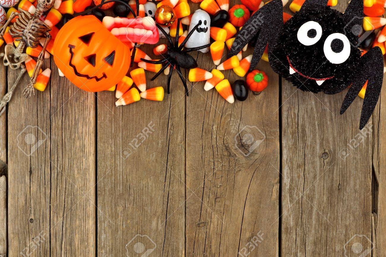 Halloween Candy And Decor Top Border Against A Rustic Wood Background Stock Photo