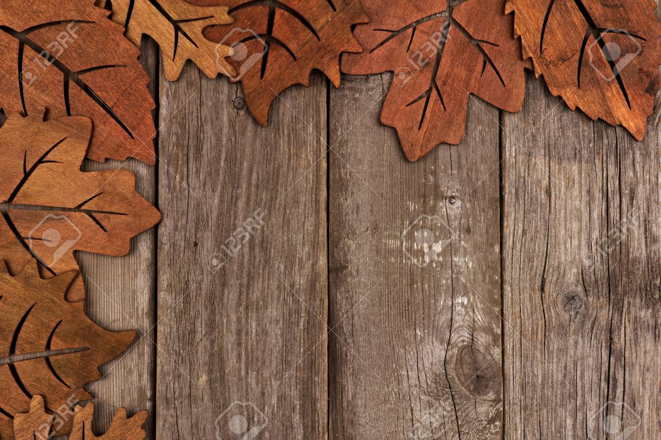 Corner Border Of Wooden Autumn Leaf Decor Against A Rustic Wood Background Stock Photo
