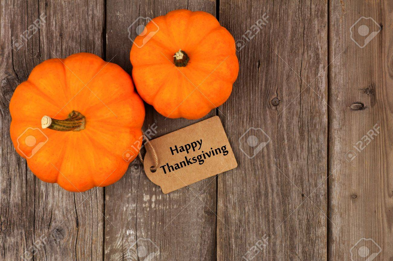Mini Pumpkins With Happy Thanksgiving Gift Tag Above View On A Rustic Wooden Background Stock