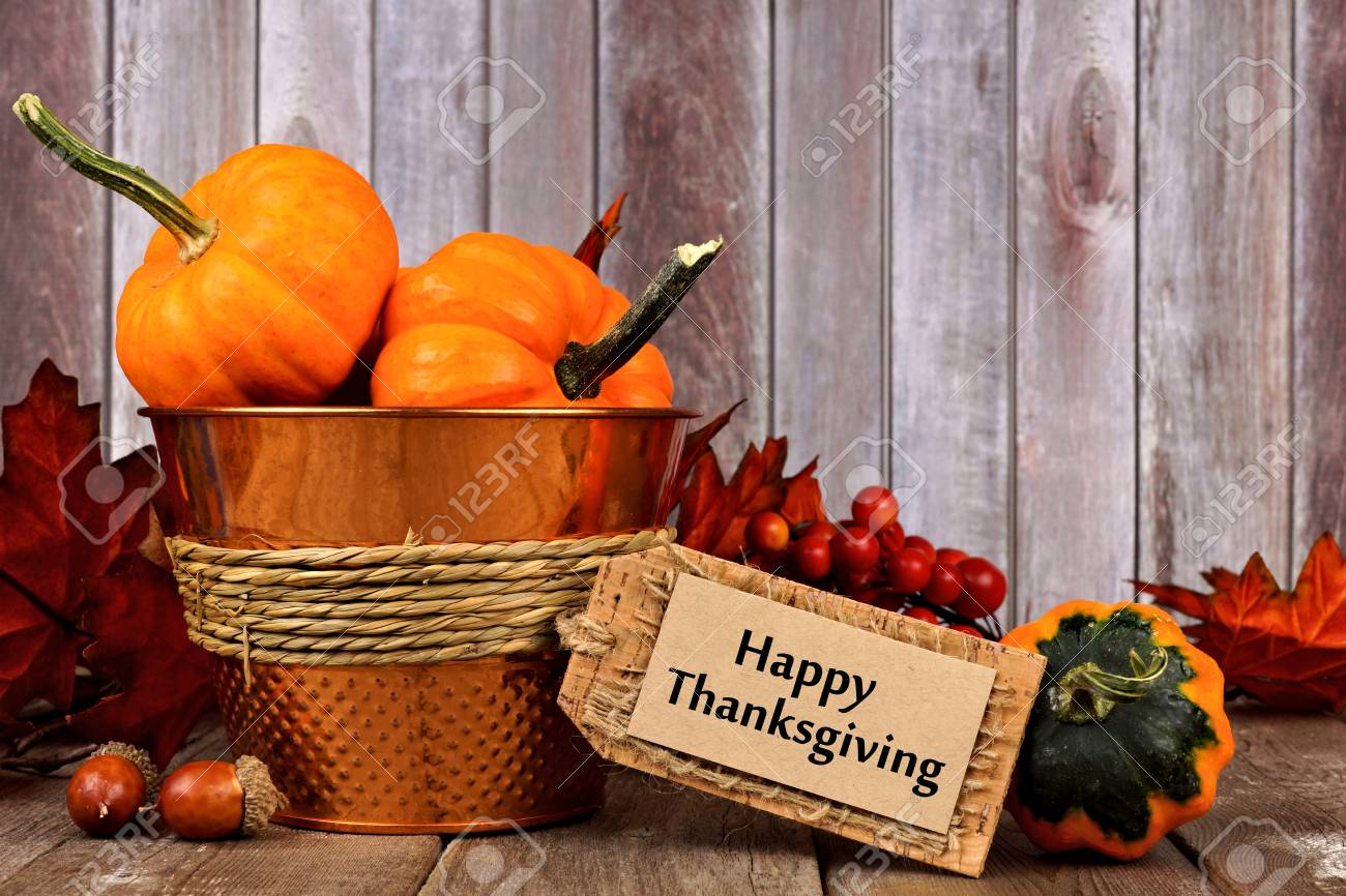 Happy Thanksgiving Tag, Pumpkins, Leaves And Autumn Home Decor With Rustic  Wood Background Stock