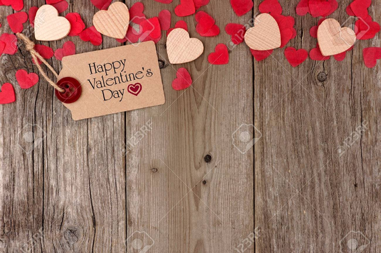 Happy Valentines Day Gift Tag With Scattered Wooden Hearts And