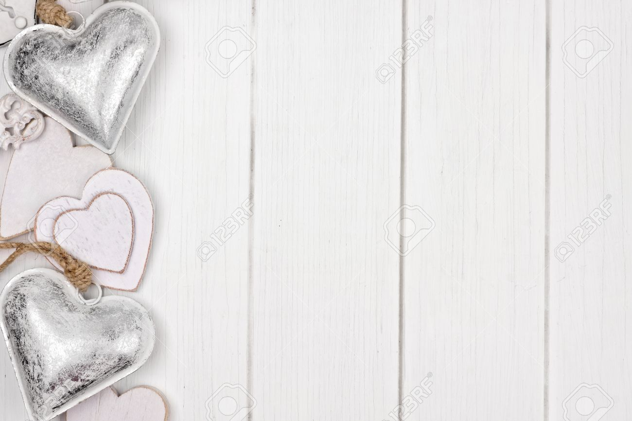 Side Border Of White And Silver Hearts Love Themed Decor On A Rustic Wood