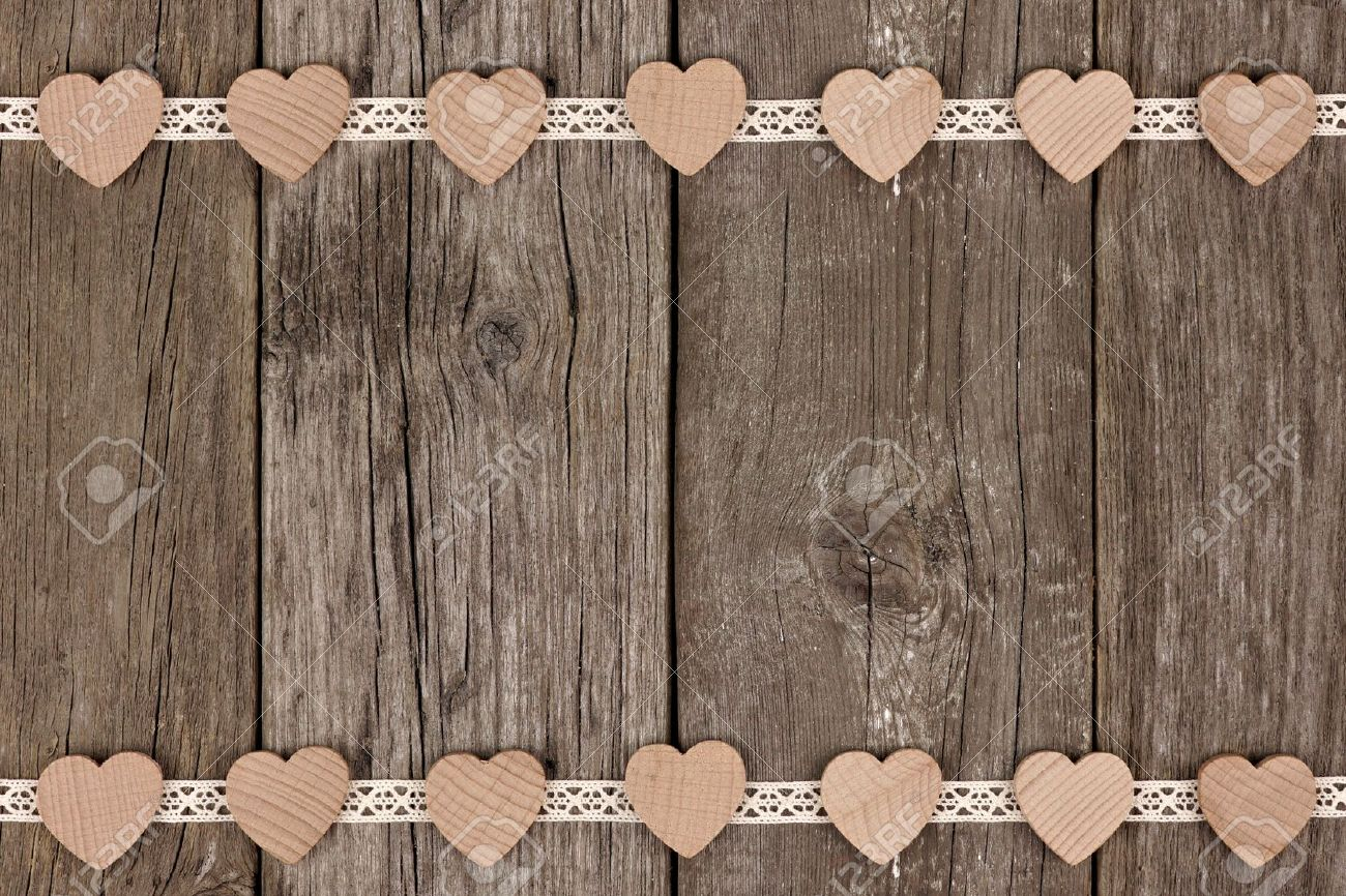 Double Border Of Wooden Hearts And Ribbon Lace Over A Rustic Background Stock Photo