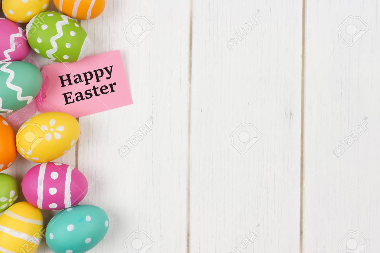 Happy easter gift tag with colorful easter egg side border against happy easter gift tag with colorful easter egg side border against a white wood background stock negle Image collections
