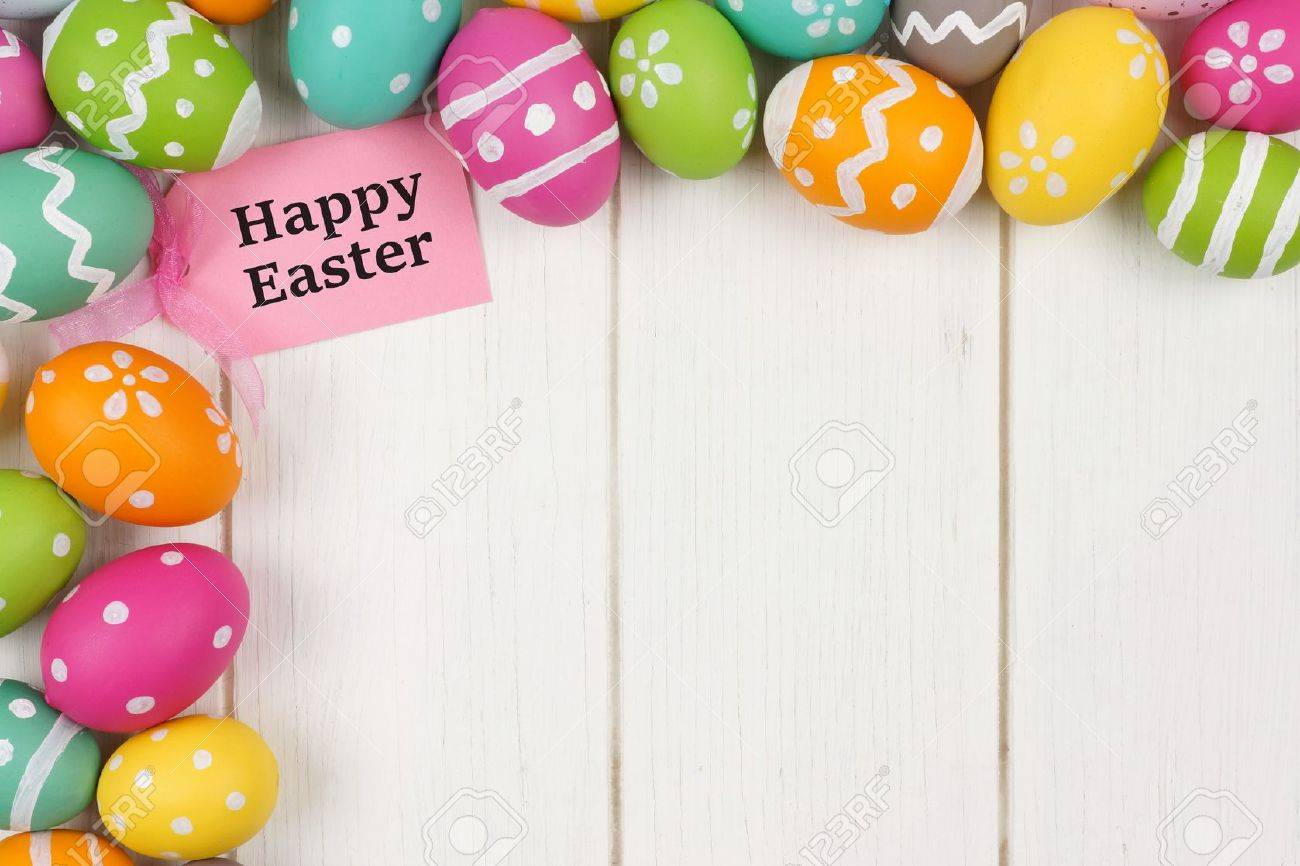 Happy easter gift tag with colorful easter egg corner border stock happy easter gift tag with colorful easter egg corner border against a white wood background stock negle