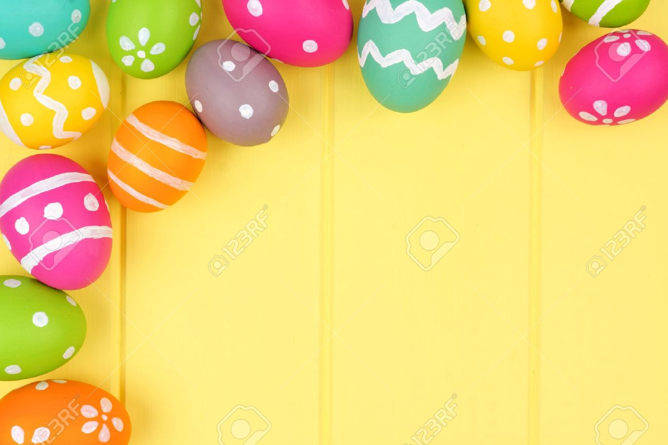 Colorful Easter Egg Corner Border Against A Yellow Wood Background Stock Photo