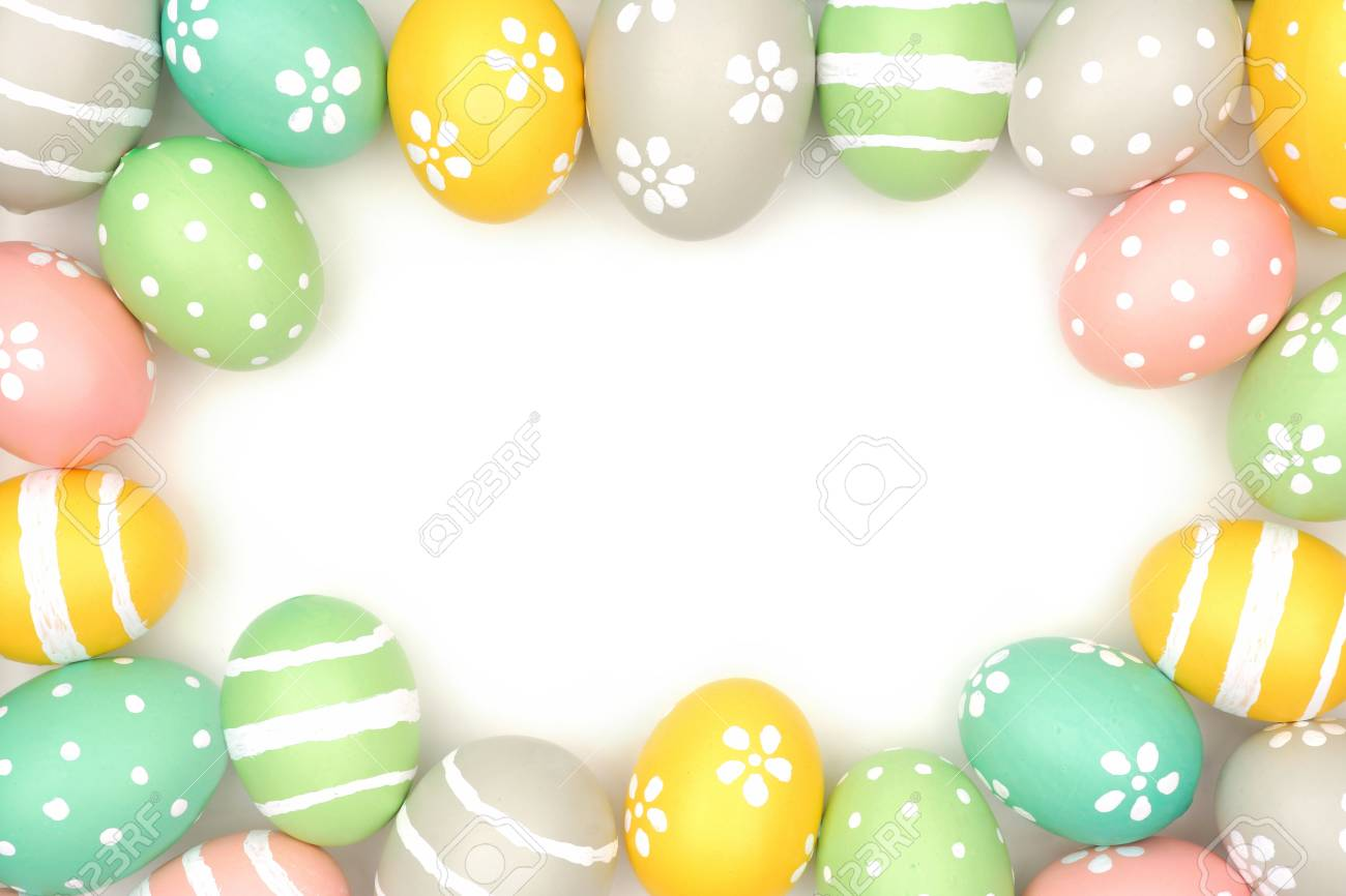 Frame Of Hand Painted Pastel Easter Eggs Over A White Background ...