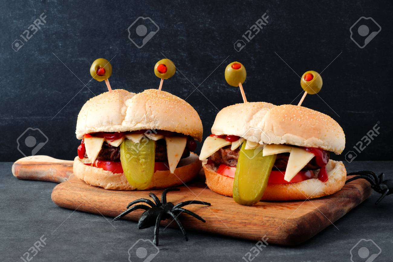 Halloween Hamburgers.Halloween Monster Hamburgers On A Paddle Board Against A Black