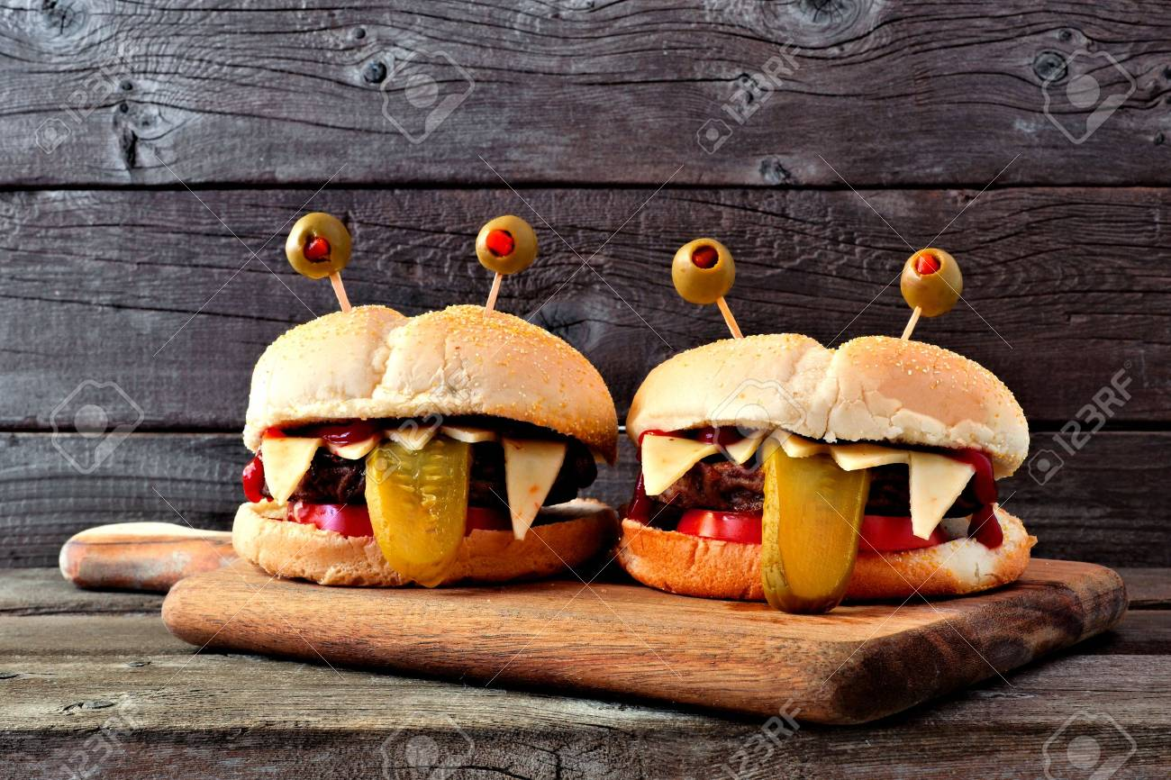 Halloween Hamburgers.Halloween Monster Hamburgers On A Paddle Board Against An Old