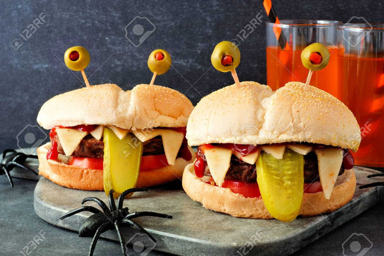 Halloween Hamburgers.Halloween Monster Hamburgers Scene Against A Black Background