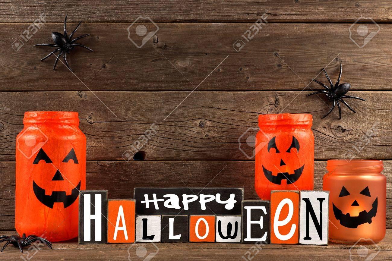 Wooden Happy Halloween Sign With Mason Jar Jack O Lanterns Against